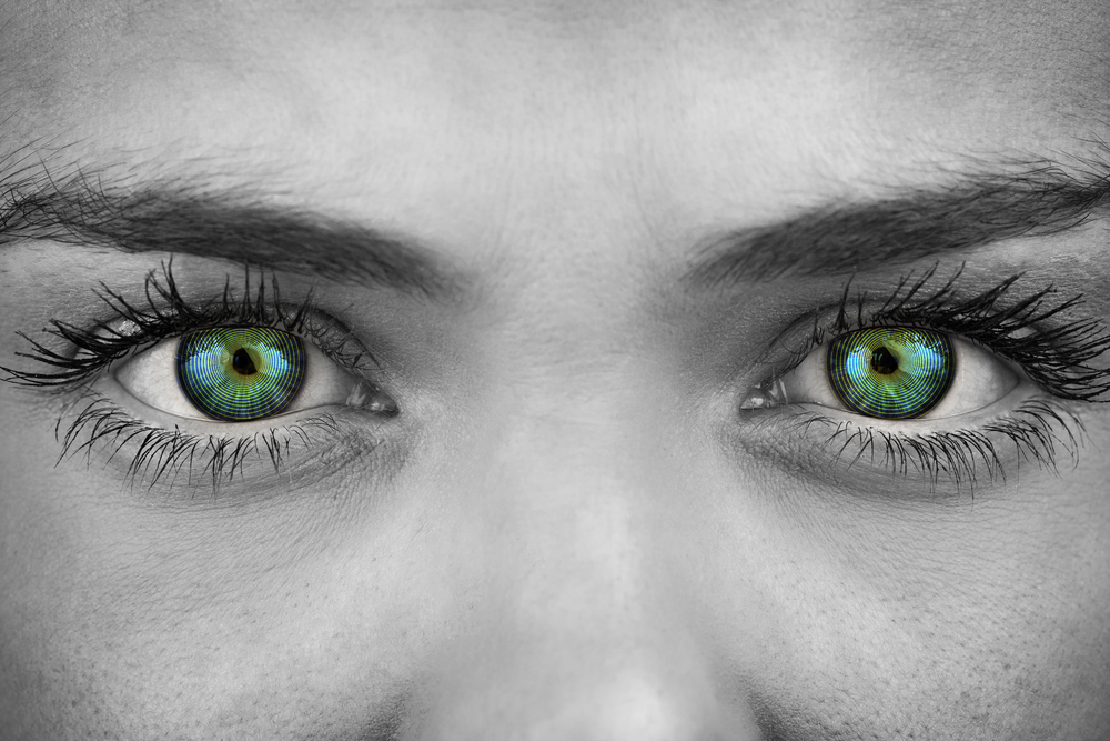 BW photo of woman with colorized green eyes