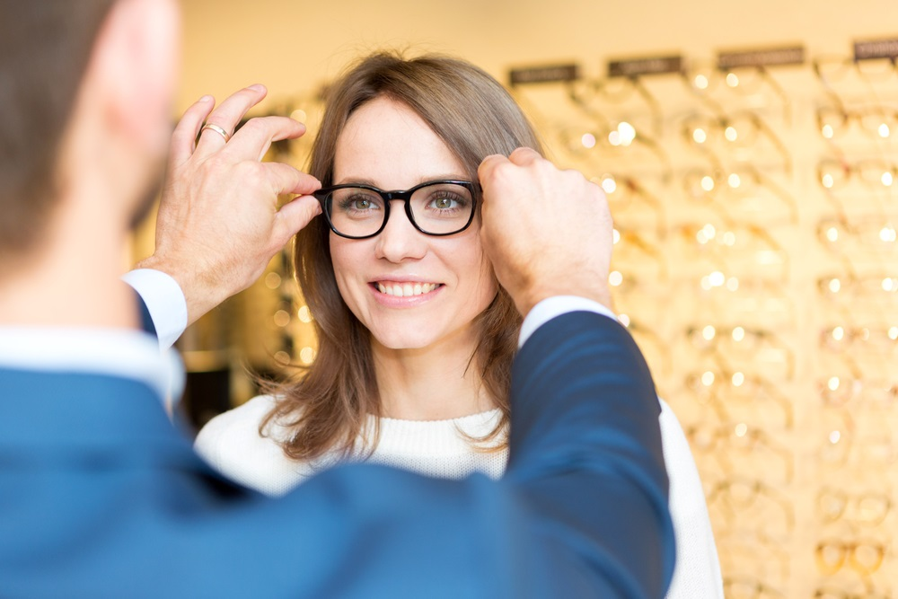 Woman Being Fitted For Glasses
