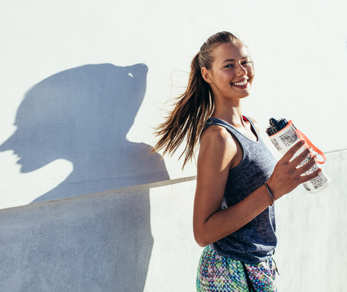 Active woman with water bottle