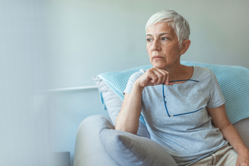 Older woman with eyeglasses considering Cataract Surgery