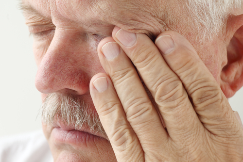 Older man suffering from dry eyes