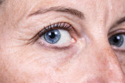 close up shot of a womans blue eyes