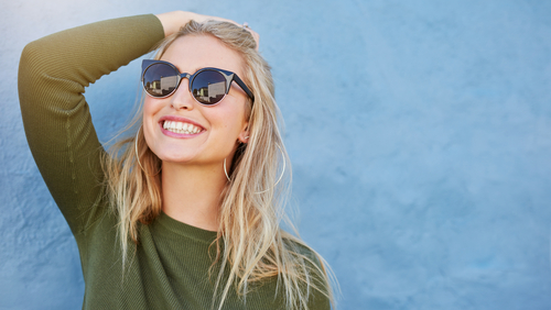 woman in green shirt and black sunglasses