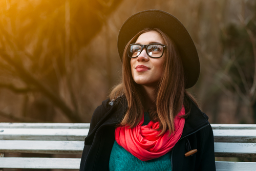 Stylish Young Woman Wearing Glasses and Considering LASIK Eye Surgery