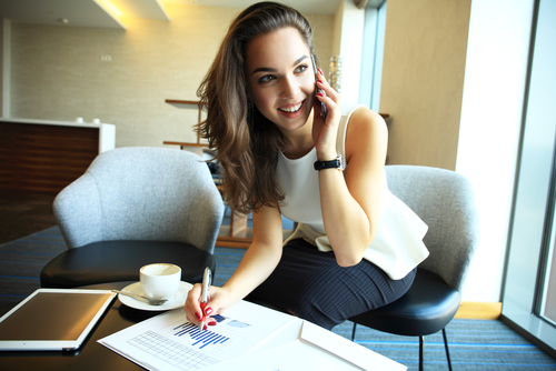 Excited Young Woman Talking on Phone
