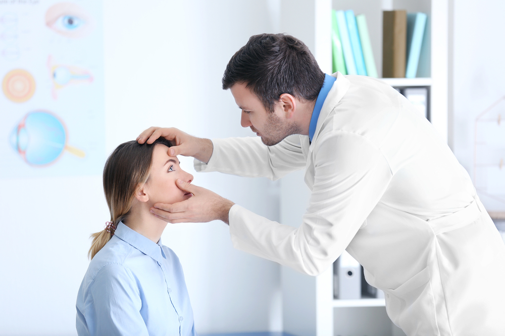 Woman having eye examined