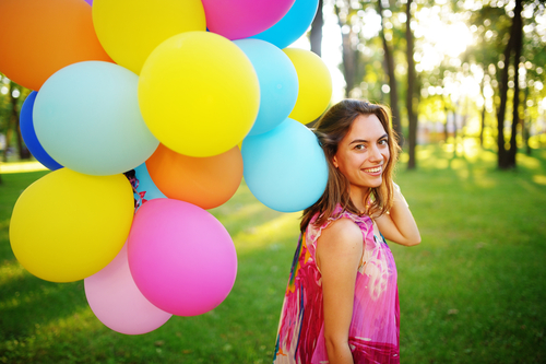 Woman with balloons in park