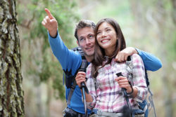 Young couple without glasses hiking