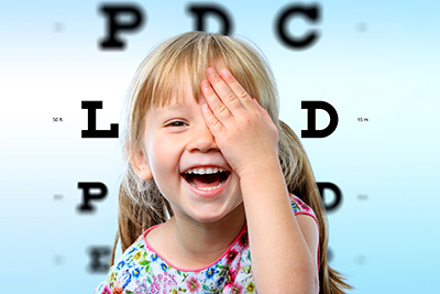 Child laughing during a visit to their pediatric ophthalmologist